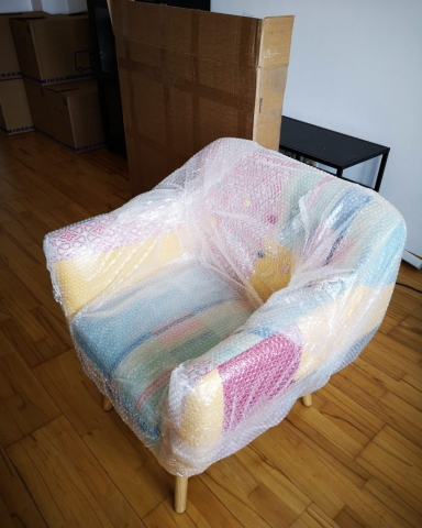 armchair wrapped in bubble paper