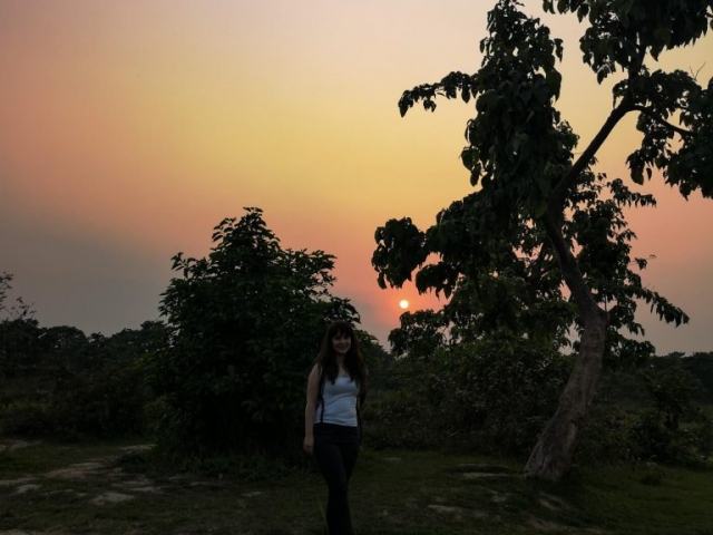 Girl in jungle at sunset