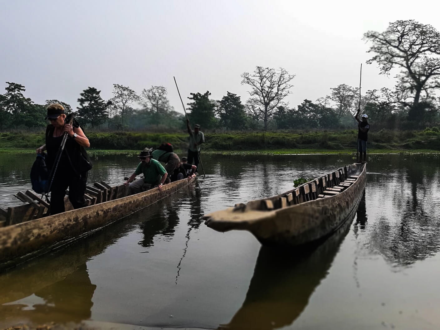 Tourists getting out of canoe
