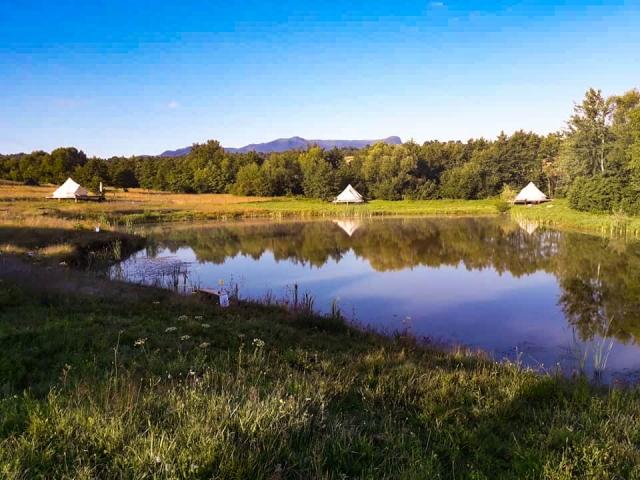 Glamping tents and lake