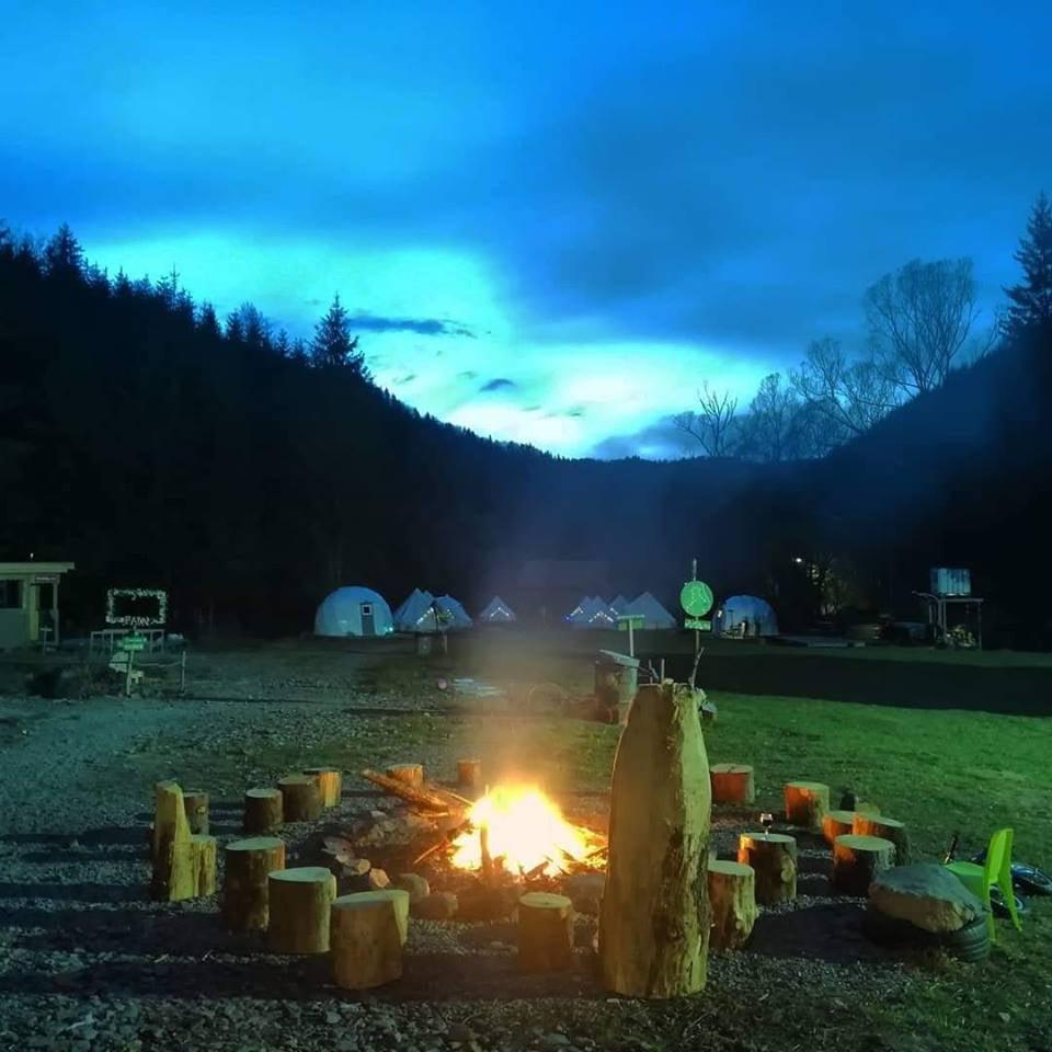 Bonfire near glamping resort at dusk