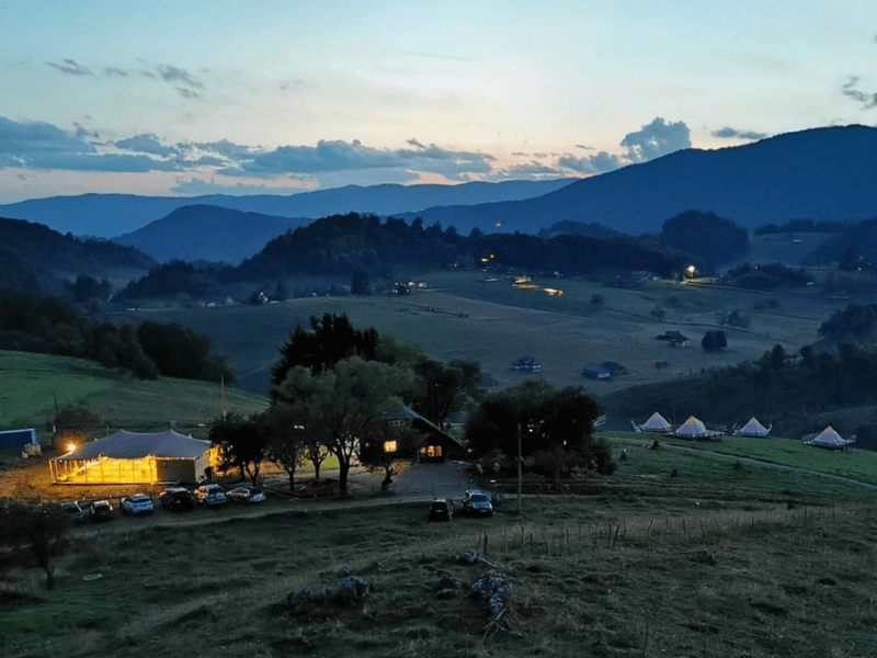 View over the glamping resort and surroundings at dusk