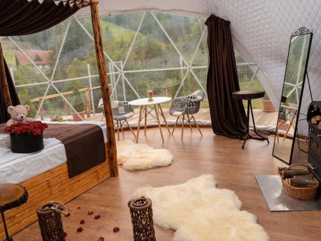 Design inside the igloo. fireplace and bed