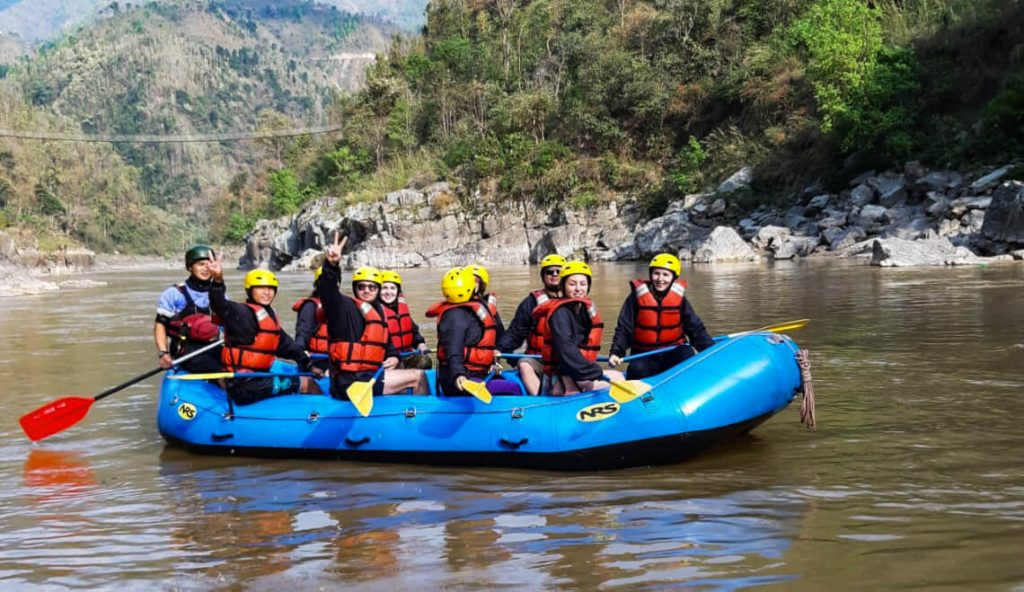 group of people in rafting boat