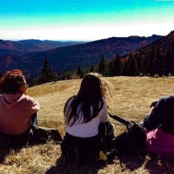 Three girls watching the mountains