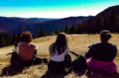 Three girls watching the mountains