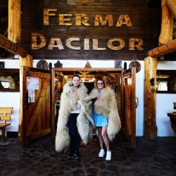 girls standing in front of Ferma Dacilor entrance
