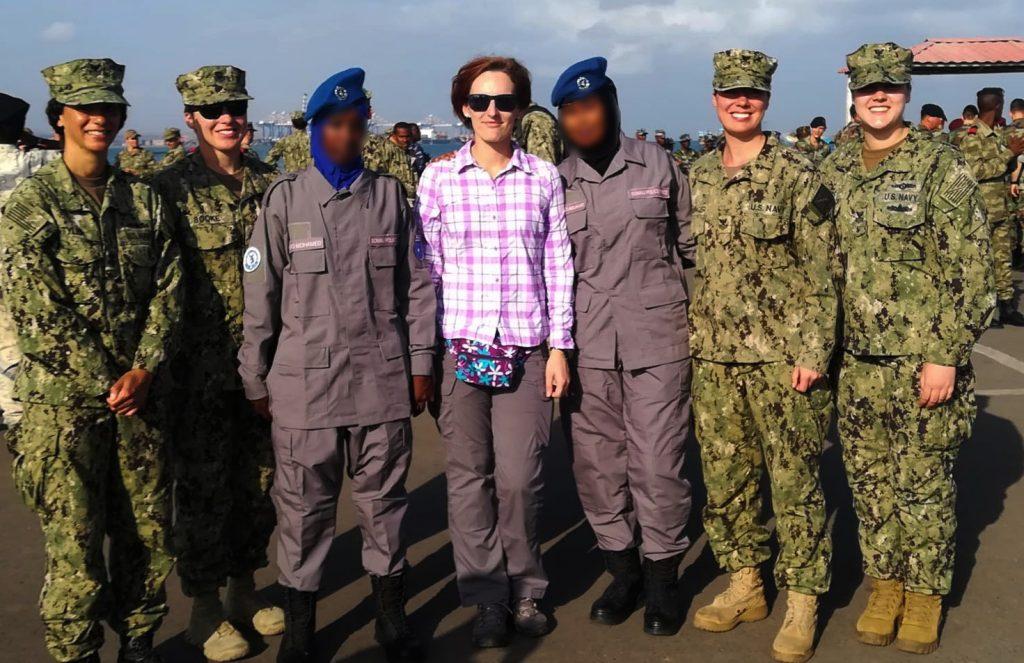 women in uniform standing
