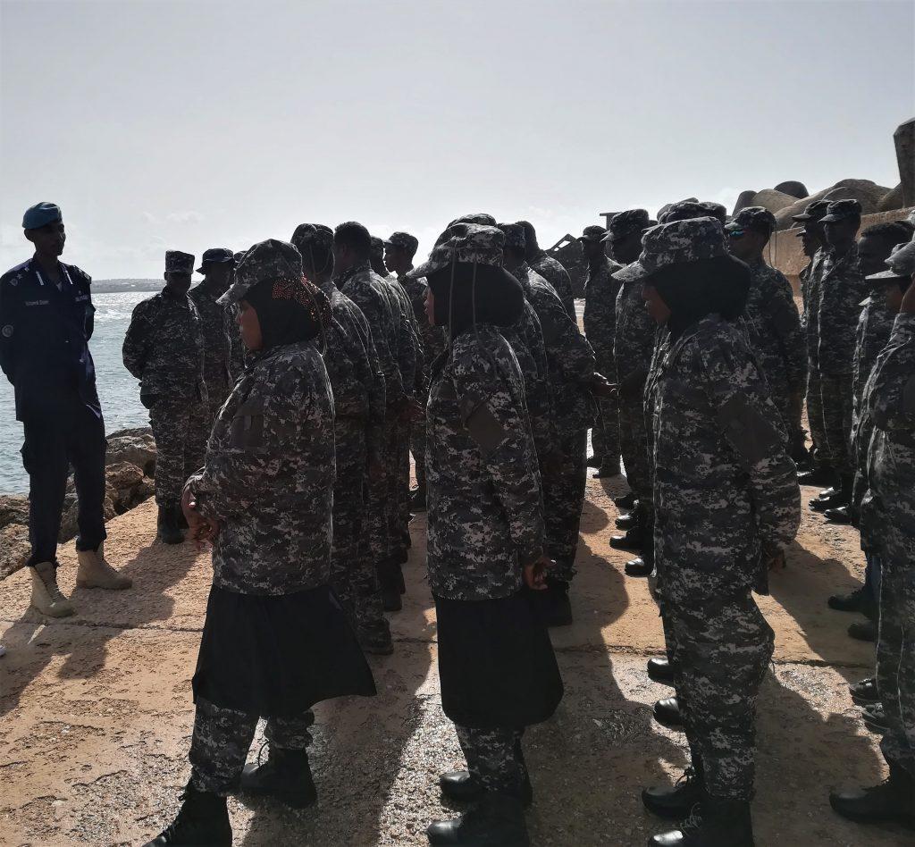 people in uniform standing
