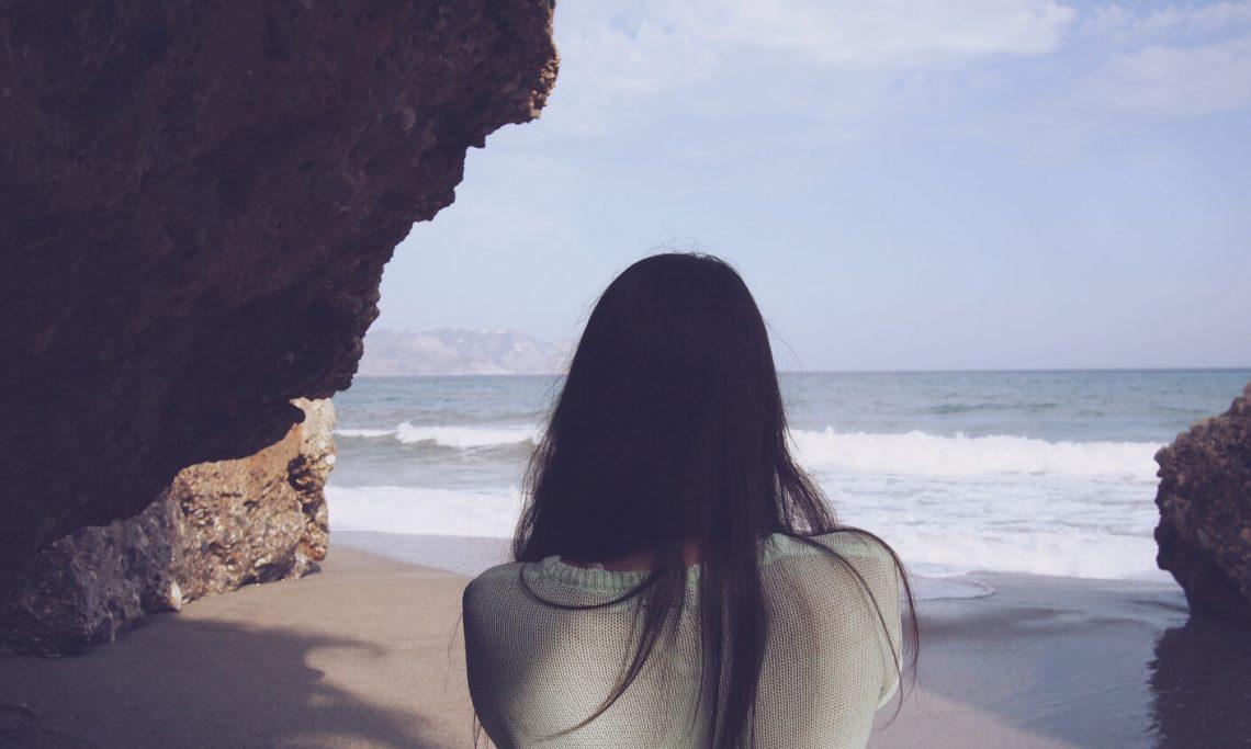 girl facing the sea
