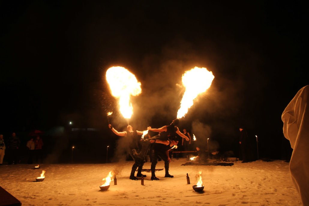 Show with dancers and fire outside of the ice hotel