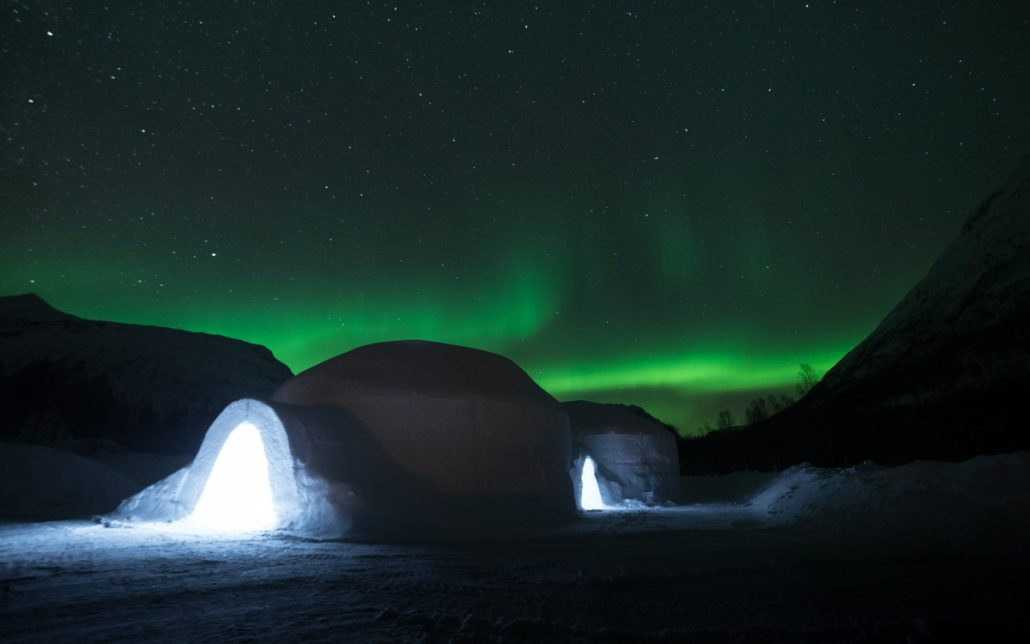 View of the ice domes with the Aurora Borealis in the sky