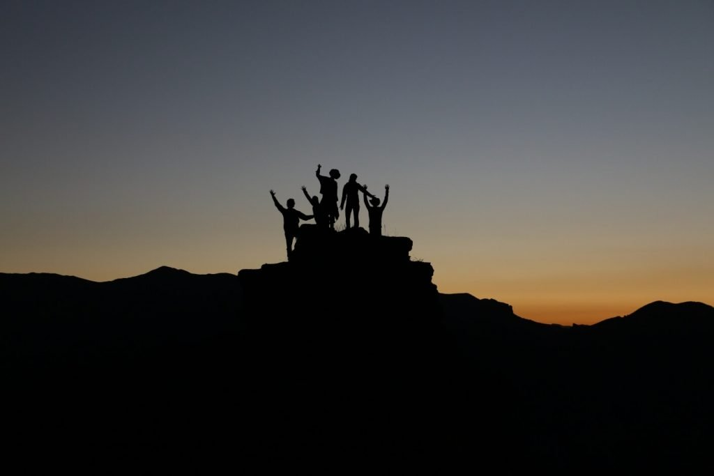 group of people in nature at sunset