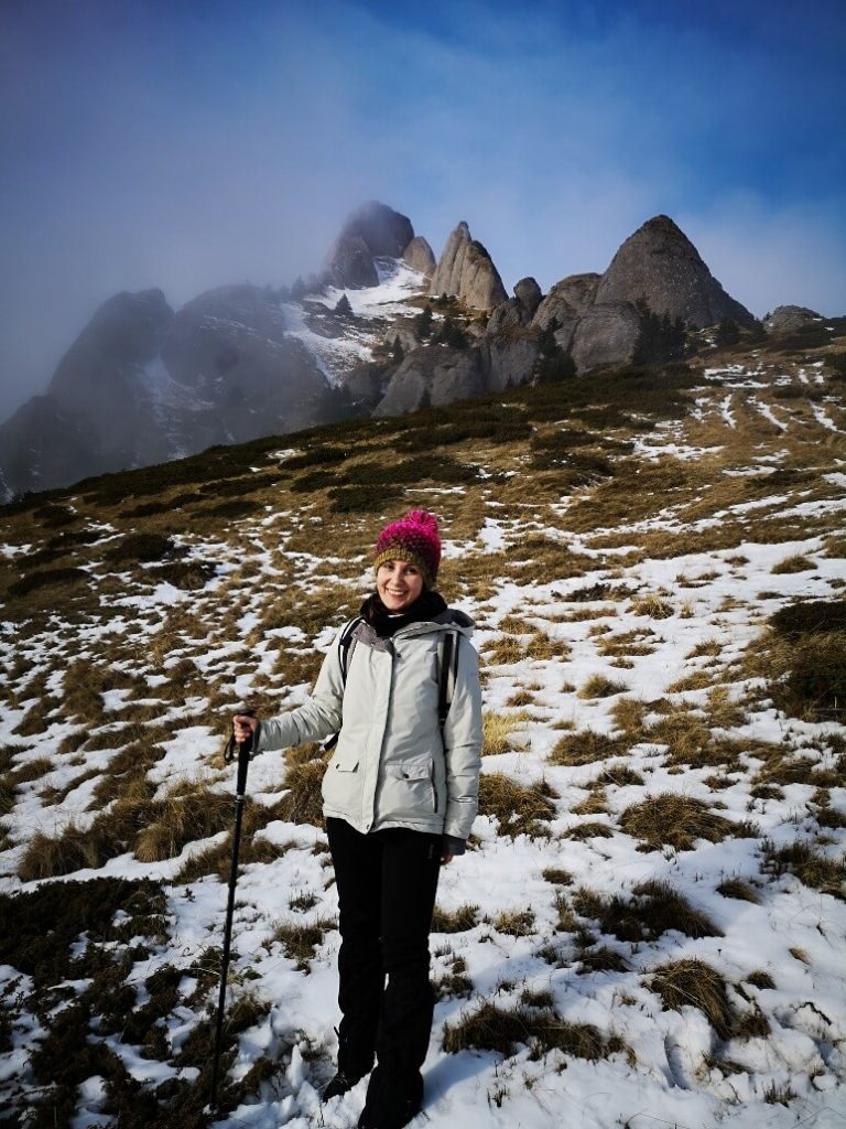 smiling girl on mountain trail