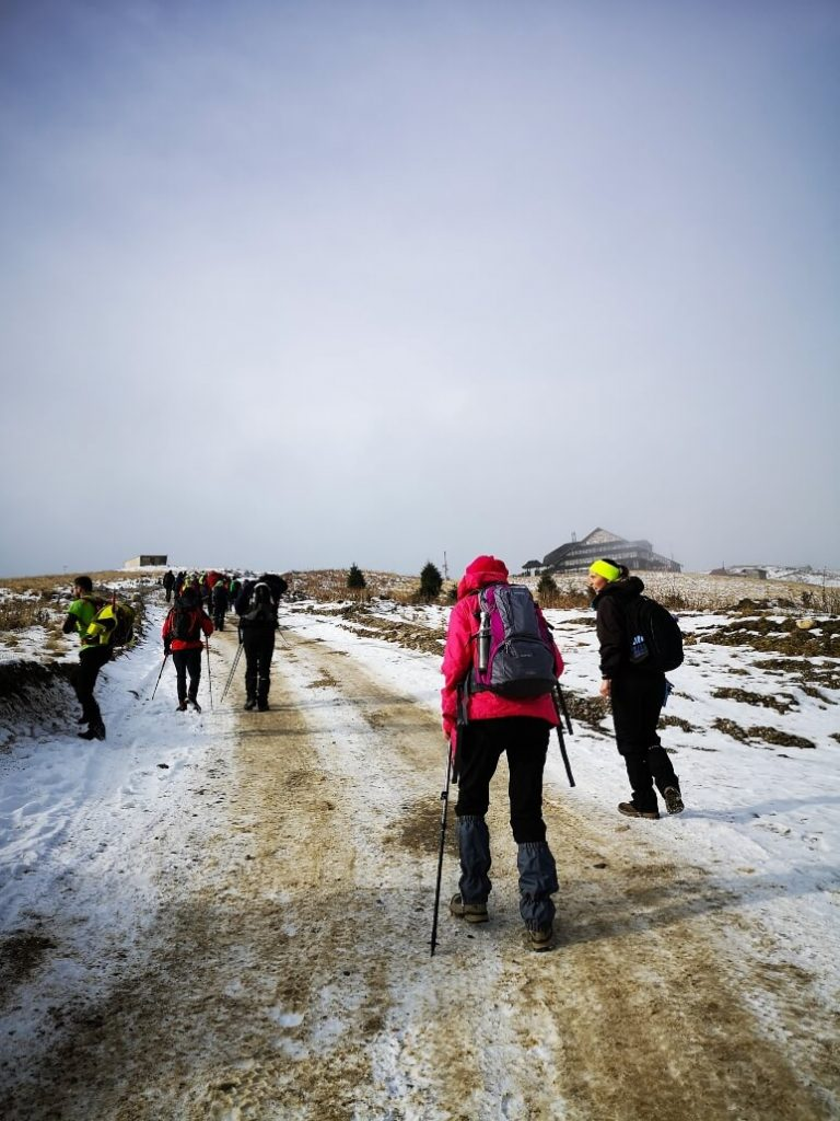People walking towards the mountain cabin