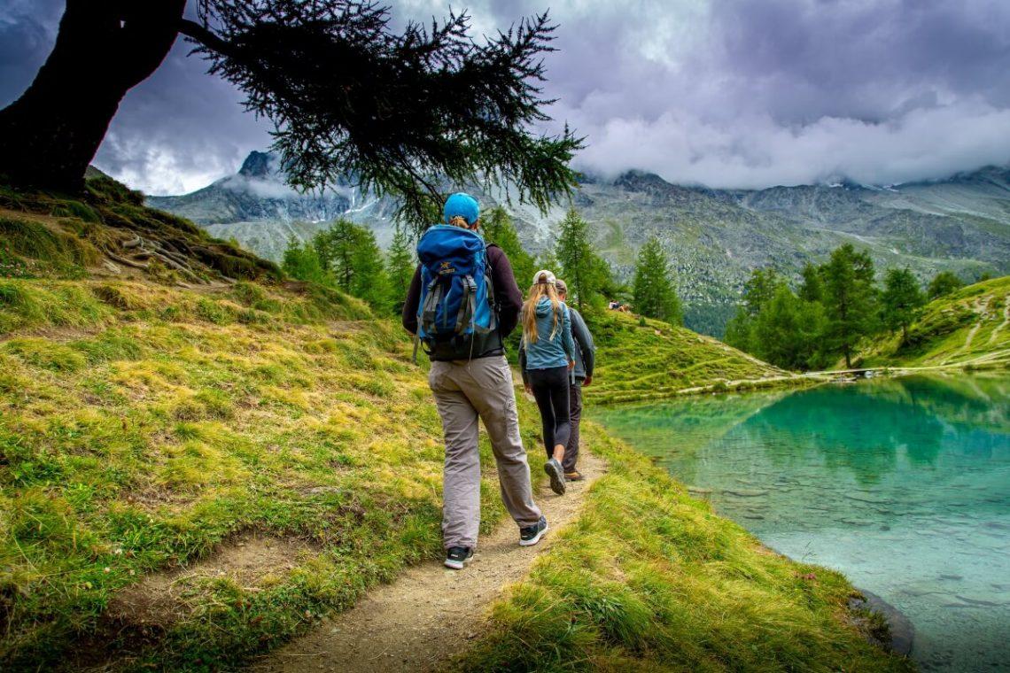 two people hiking near lake
