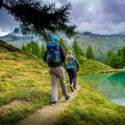 two people hiking near lake