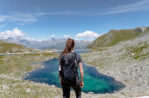 Woman watching a lake in the mountains