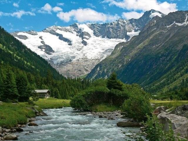 View of mountain river and small hut in Hohen Tauern National Park