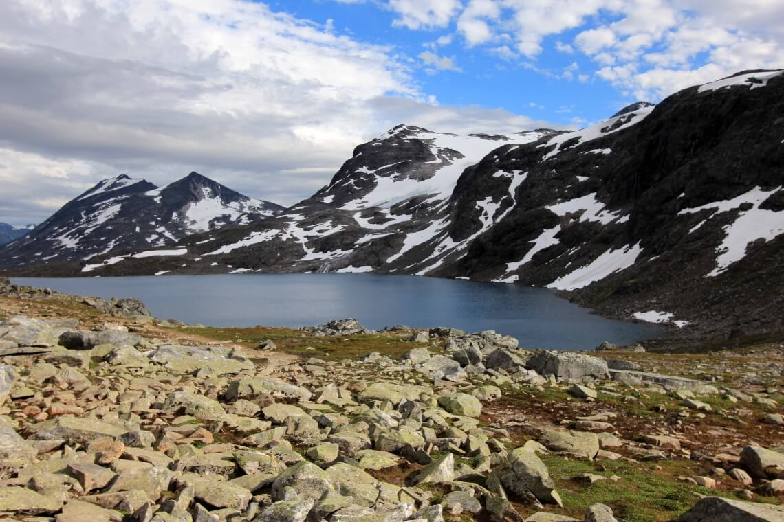 View over lake and snowy mountains in Jotunheimen National Park