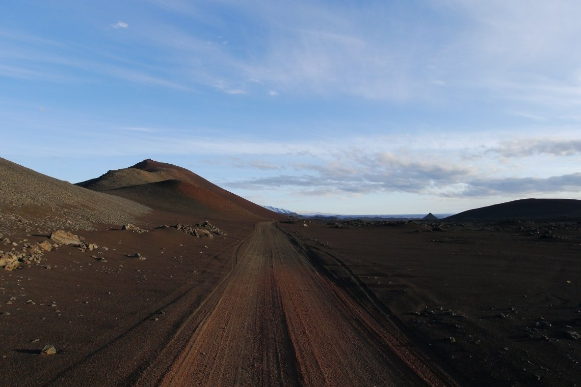 Road on the volcanic the black ground