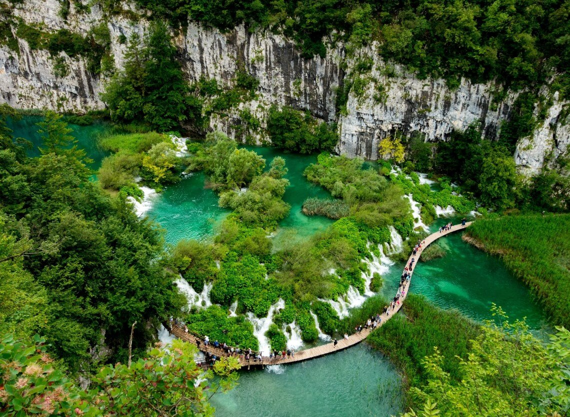 View from above of waterfall and bridge in Plitvice National Park