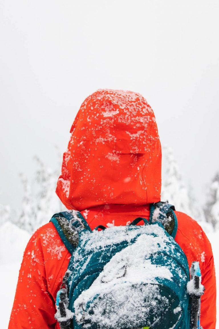 red hardshell jacket in winter