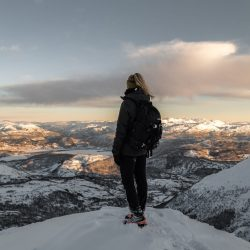 Girls in hardshell jacket on mountain top