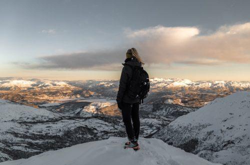 Girls in hardshell jacket on mountain top
