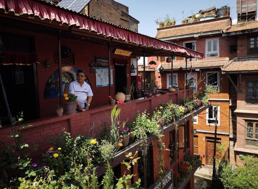Hotel owner on a porch in Baktapur, Nepal