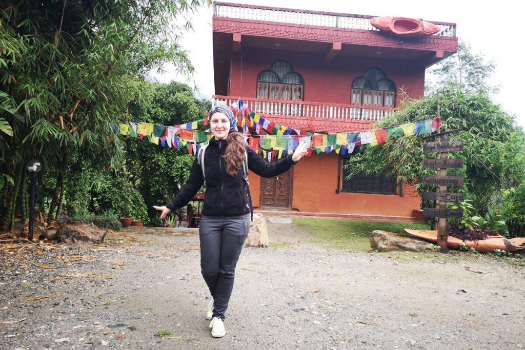 Girl in front of entrance at the rafting camp in Nepal