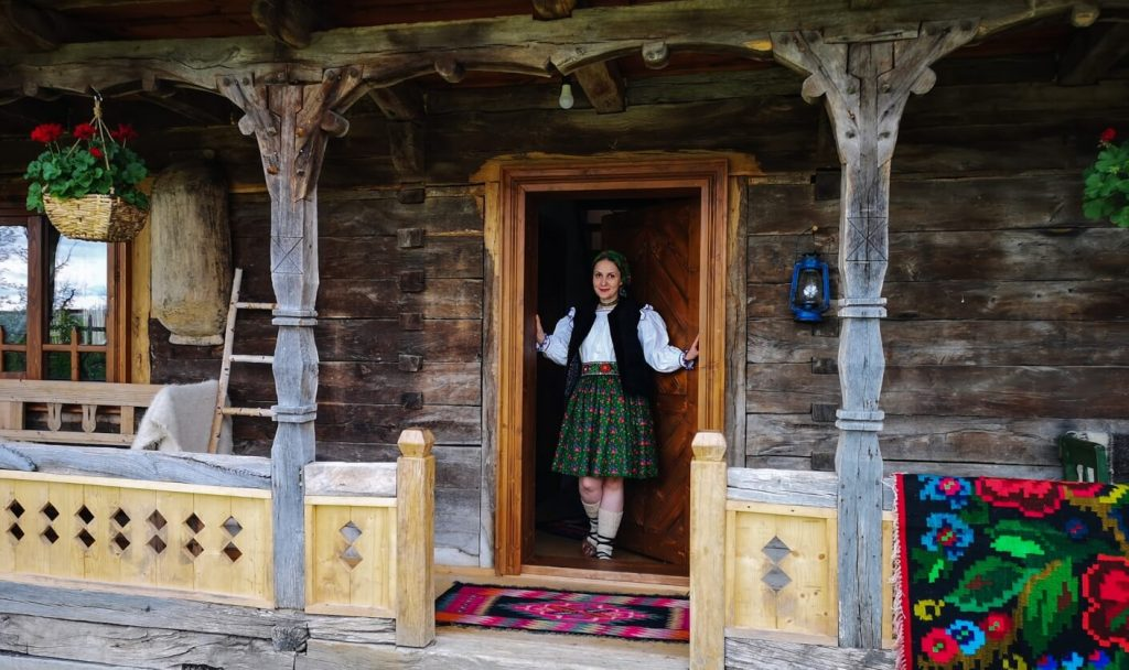 Girl in front of the door at Casa din Susani